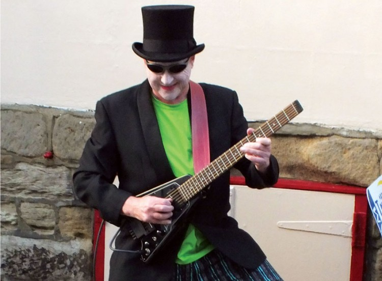 Goth playing guitar in Whitby