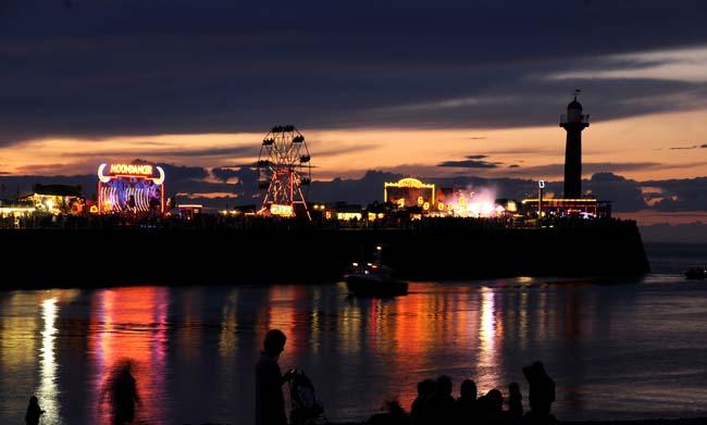 The fun fair on the pier at night – © Ceri Oakes/Whitby Gazette