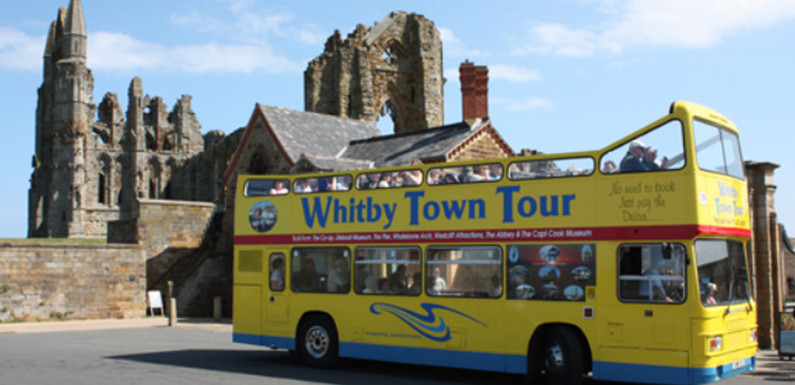open top bus delivering a Whitby town tour