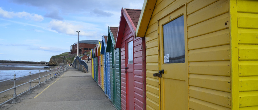 image of the beach and huts at Whitby