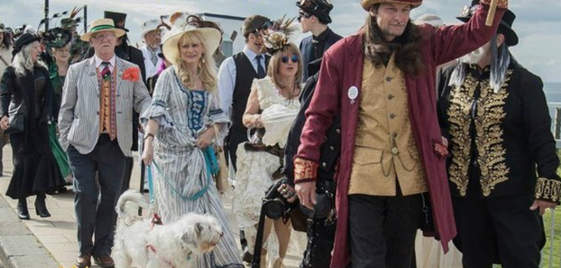 People in costume dressed up and walking at the Whitby Steampunk Weekend