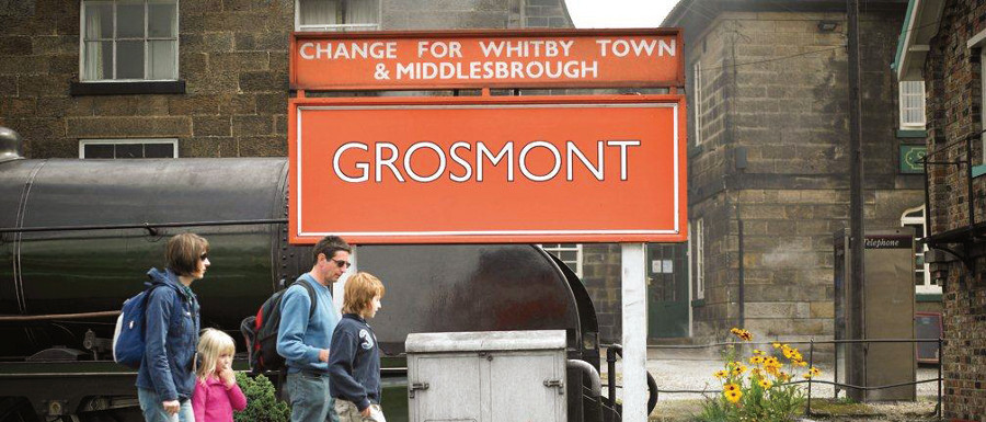 family getting of a train at Grosmont station to visit the 60s music festival