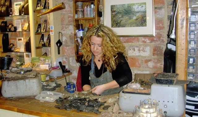 woman from Ebor Jetworks creating jewellery made from Whitby jet