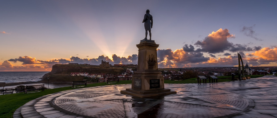 Captain James Cook statue overlooking the town as the sun sets