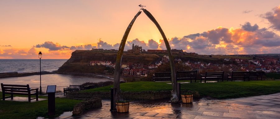 whitby whale bones overlooking the town as the sun sets