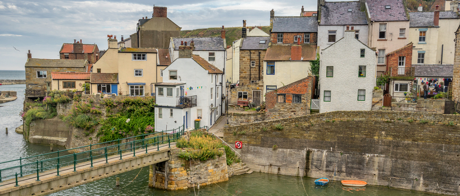 boats docked in Staithes next to houses