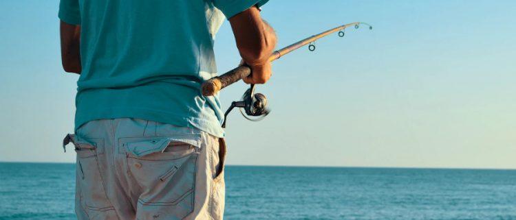 man fishing on Whitby's beach