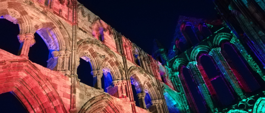 walls of Whitby Abbey illuminated