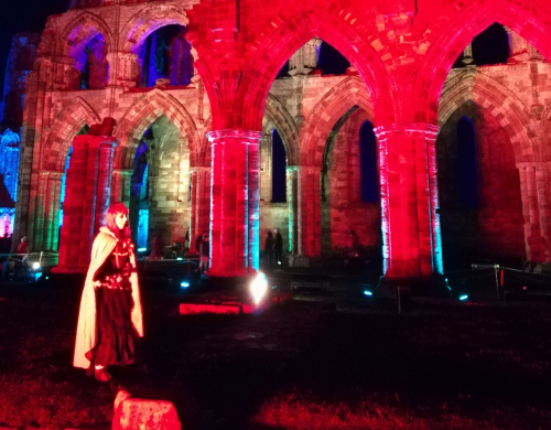 witch at Whitby Abbey illuminated