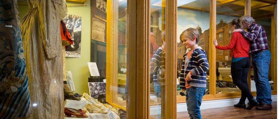 family looking at collections in the Whitby Museum