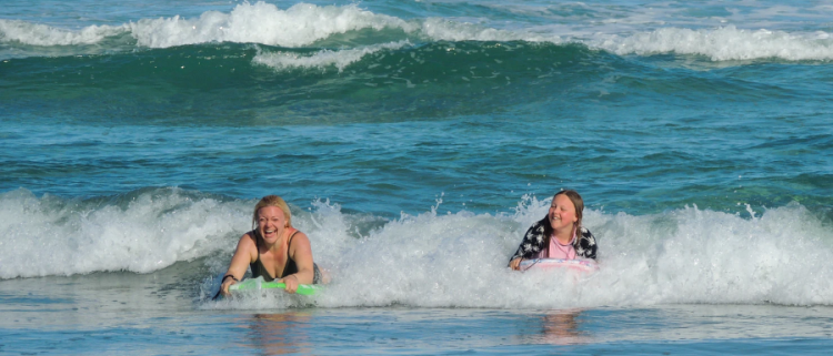 mother and daughter playing together in the sea