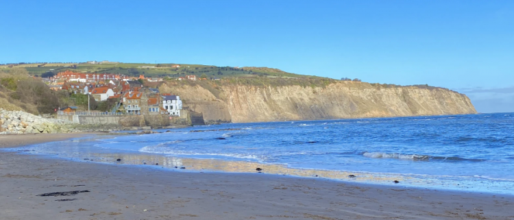 sand, sea and cliffs in Whitby