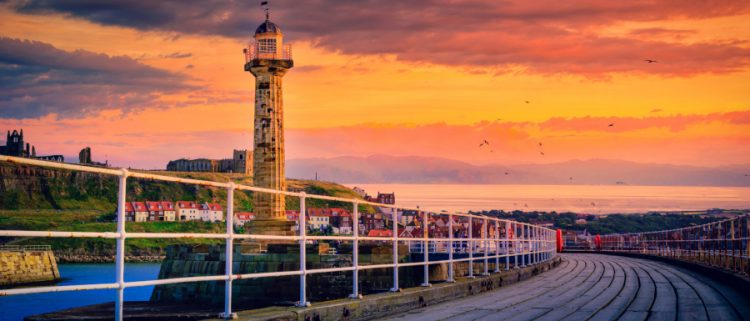 Whitby pier at sunset as a best places to propose