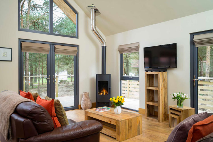 Relax in the comfort of the lodges at Ladycross Plantation and unwind by the wood burning stove