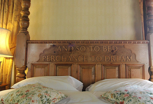 The charming carved four-poster bed at Bagdale Hall Hotel, Whitby