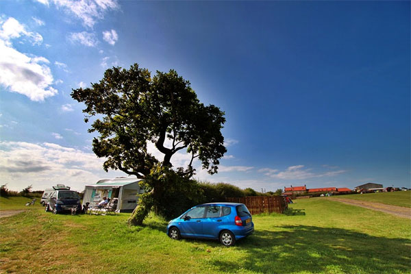 The charming camping field for caravans at Broadings Farm Caravan and Camping Park, Whitby