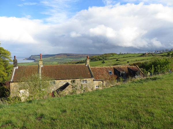 Tucked below heather clad moorland with commanding views over Robin Hood's Bay, Skerry Hall Farm