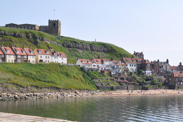 The view of the picturesque cottages East Pier, East Cliff Cottages, Whitby