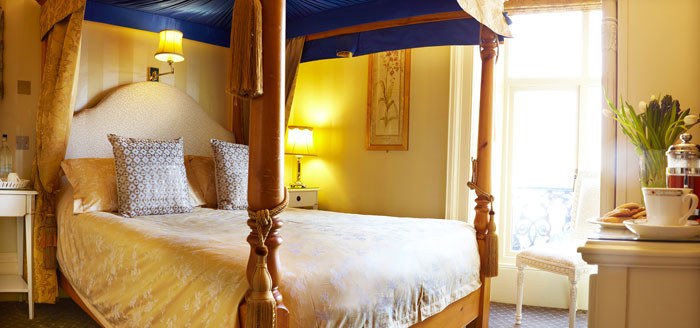 A stunning four-poster bedroom at The Haven Guest House, Whitby