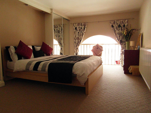 The delightful mezzanine double bedroom at The Court, Metropole Luxury Apartments, Whitby