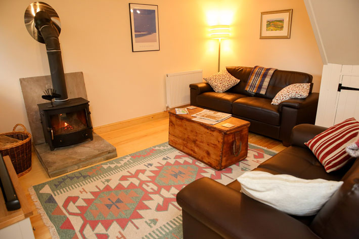Comfortable, modern living room of Partridge Nest Farm cottage in Whitby