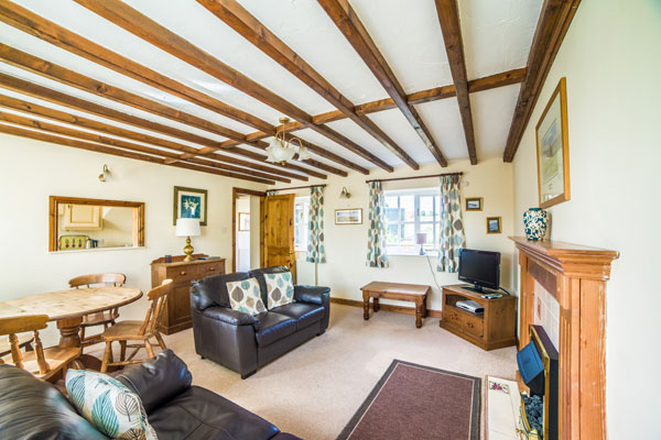 The light and airy lounge at Stable Cottage, Sandfield House Farm Caravan and Camping Park, Whitby
