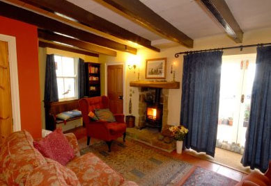 Cosy lounge and dining area at Pennysteel Cottage, Whitby