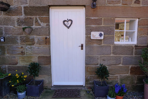 The quaint front door at The Hayloft, Whitby