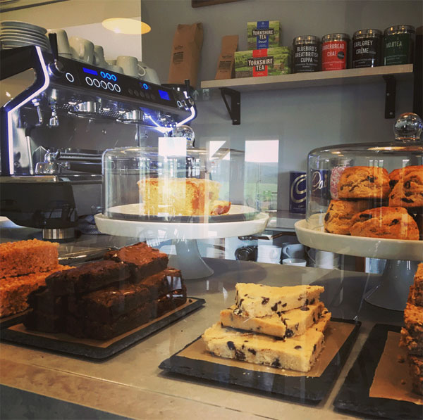 Lovely array of treats and coffee machine at Yorkshire Cycle Hub, Whitby