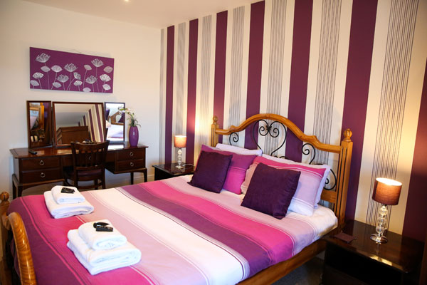 A striking double bedroom at The Riviera Guest House, Whitby