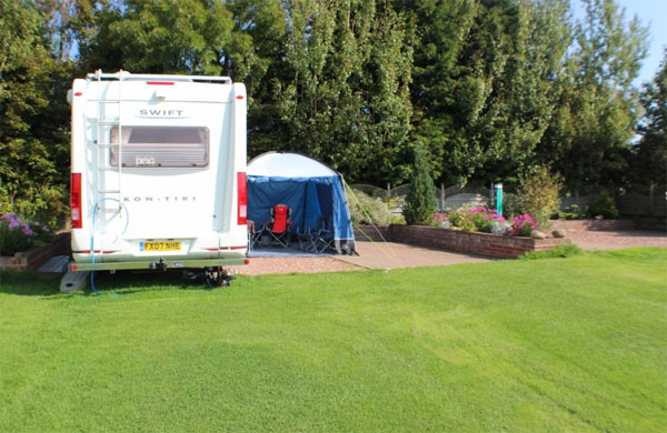 A hard-standing pitch at Serenity Touring Caravan & Camping Park, Whitby