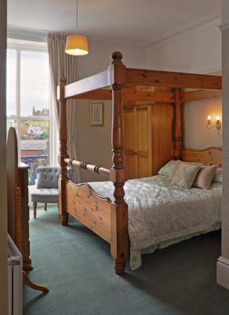 A stunning four-poster bedroom at Number Seven Guest House, Whitby