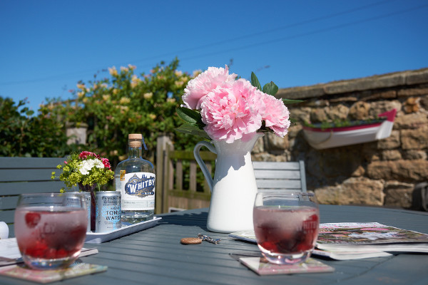 outdoor table with Whitby gin and decorations